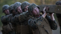 U.S. Marines with 8th Marine Regiment, 2nd Marine Division execute log-lifts as part of combat conditioning exercises on Camp Lejeune, N.C., March 23, 2018. The Marines performed the exercises to improve upon both their physical and mental strength.
