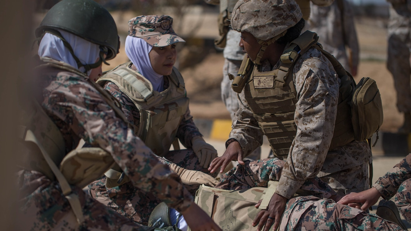 Female Marine teaches life saving tactics.