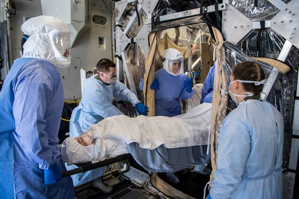 Air Mobility Command Airmen load a patient into the transportable isolation system during a training event at Joint Base Charleston, S.C., March 14, 2018.