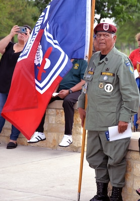 A retired Army Special Force sergeant major stands at attention during the National Anthem at the 50th Anniversary of the Commemoration of the Vietnam War at the Fort Sam Houston National Cemetery March 27.