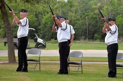 Members of the Memorial Services Detachment render honors by volleys of rifle fire near the conclusion of the ceremony for the 50th Anniversary of the Commemoration of the Vietnam War at the Fort Sam Houston National Cemetery March 27.