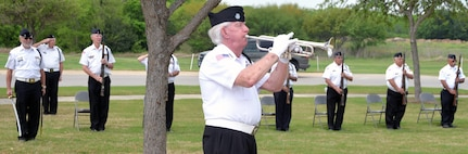 """A member of the Fort Sam Houston Memorial Services Detachment plays """"Taps"""" near the end of the ceremony for the 50th Anniversary of the Commemoration of the Vietnam War at the Fort Sam Houston National Cemetery March 27."""