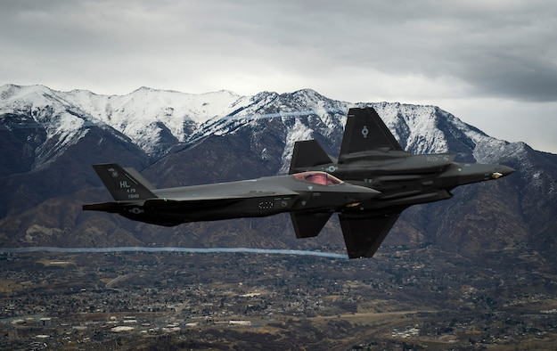 Two U.S. Air Force F-35s fly over Hill Air Force Base, Utah, and the surrounding area