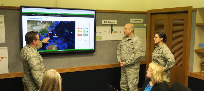 (From left to right) Major Nick Kirsch, Maj. Gen. Michael Brewer and Col. Francesca Bartholomew of Air Force Materiel Command review the analysis from an ISWAT scenario.  The new ISWAT technology, developed by an Ohio company with support from the Air Force SBIR/STTR Program technology, provides a more realistic impact of logistics in long-term conflicts. (Air Force photo)