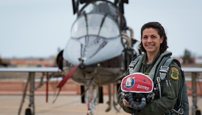 U.S. Air Force Lt. Col. Cheryl Buehn, 71st Fighter Training Squadron T-38A Talon nstructor pilot, poses in front of T-38A Talons at Joint Base Langley-Eustis, Virginia, March 27, 2018.