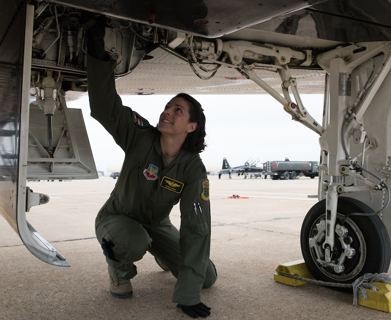 U.S Air Force Lt. Col. Cheryl Buehn, 71st Fighter Training Squadron T-38A Talon instructor pilot, performs preflight inspections on a T-38A Talon at Joint Base Langley-Eustis, Virginia, March 27, 2018