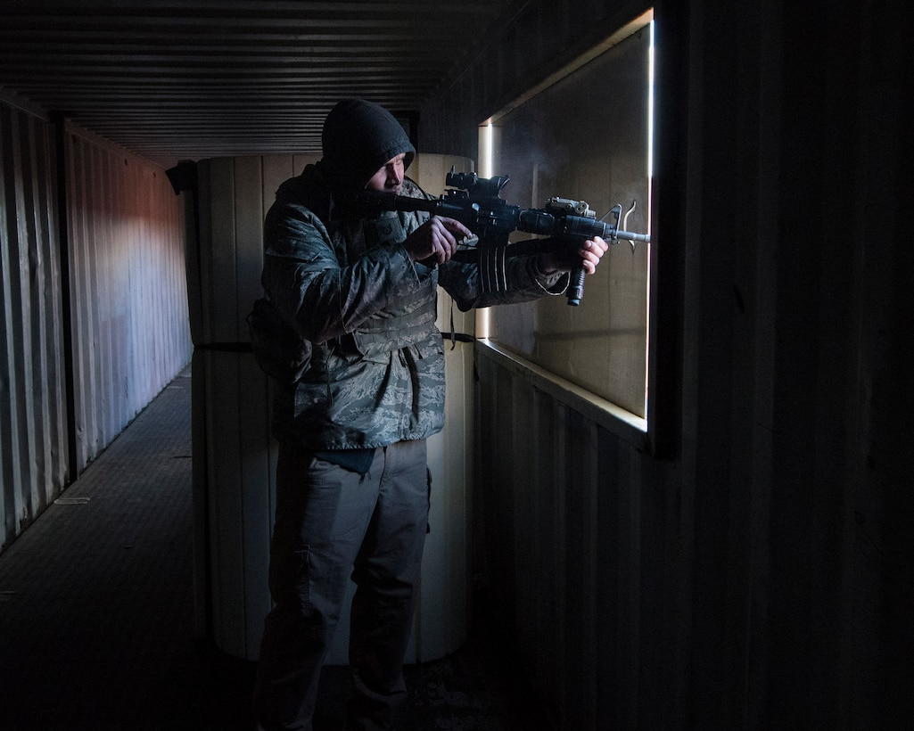 Tech. Sgt. Ryan Krastins, 141st Security Forces Squadron security forces specialist, plays the role of the opposing force during a field training exercise at the Urban Evasion Laboratory March 9, 2018 at Fairchild Air Force Base, Wash. The Guardsmen practiced several training scenarios while conducting the training to include moving a squad within the UEL to secure the area from hostile forces in order to set up a bare base of operations. (U.S. Air National Guard photo by Staff Sgt. Rose M. Lust)