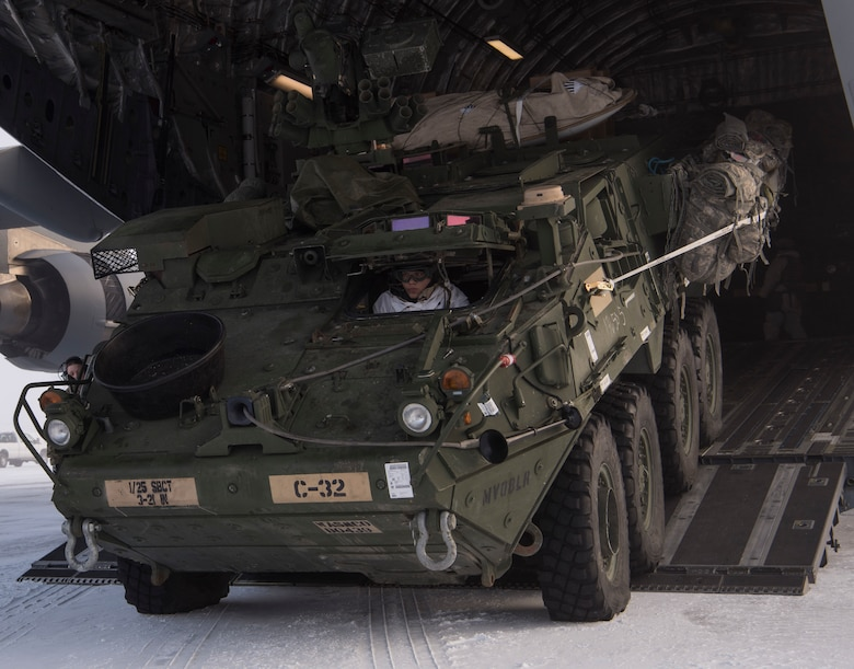 A U.S. Army Soldier drives an Interim Armored Vehicle Stryker out of a C-17 Globemaster III during Exercise Arctic Pegasus at Deadhorse, Alaska, March 13, 2018. The 62nd Airlift Wing participated in the exercise by transporting Soldiers and Strykers from Eielson Air Force Base, Alaska, to Deadhorse. (U.S. Air Force photo by Senior Airman Tryphena Mayhugh)