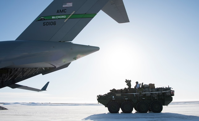 A U.S. Army Soldier drives an Interim Armored Vehicle Stryker onto a C-17 Globemaster III during Exercise Arctic Pegasus at Deadhorse, Alaska, March 13, 2018. Airmen assigned to the 62nd Airlift Wing flew two C-17 Globemaster IIIs to deliver Army Soldiers and four Strykers to Deadhorse for the exercise. (U.S. Air Force photo by Senior Airman Tryphena Mayhugh)