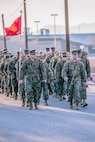 Major Alfredo Romero,  Head quarters Company commanding officer (left) marches with 1st Sgt. Neil Roselli, HqCo 1st Sgt., during a conditioning hike with the company Marines aboard Marine Corps Logistics Base Barstow, Calif., March 16.