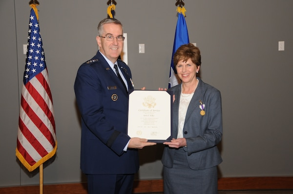 U.S. Air Force Gen. John Hyten, commander of U.S. Strategic Command (USSTRATCOM), presents a certificate of service to Kerry Kelley during her retirement ceremony at the new USSTRATCOM command and control facility at Offutt Air Force Base, Neb., March 9, 2018. Kelley was recognized for her 32 years of civil service with Strategic Air Command and USSTRATCOM. She will continue to serve as USSTRATCOM director of Command and Control, Communications, Computer (C4) Systems; chief information officer; and director of the Joint Cyber Center until her official retirement date of March 31, 2018.  USSTRATCOM has global responsibilities assigned through the Unified Command Plan that include strategic deterrence, nuclear operations, space operations, cyberspace operations, joint electromagnetic spectrum operations, global strike, missile defense, and analysis and targeting.