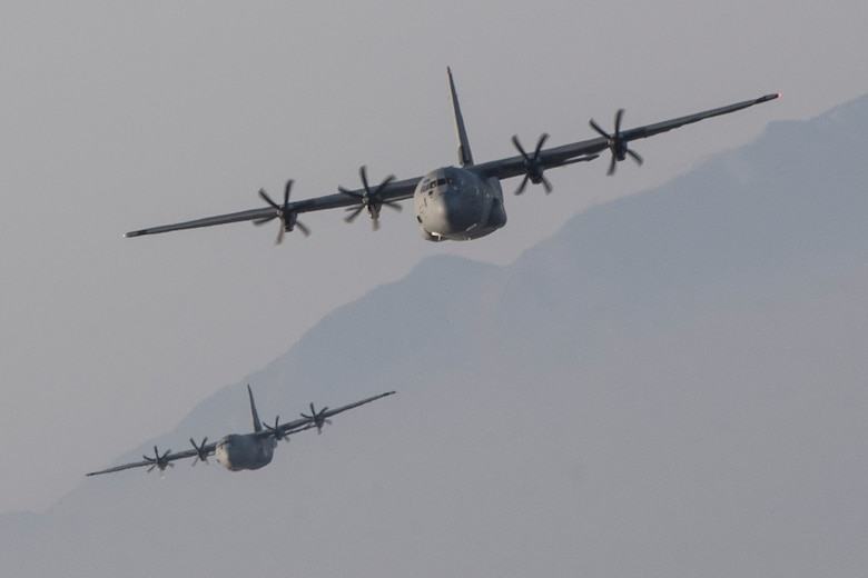 Two Air Force C-130J Super Hercules assigned to the 36th Airlift Squadron fly over Sizuoka prefecture, Japan, March 26, 2018
