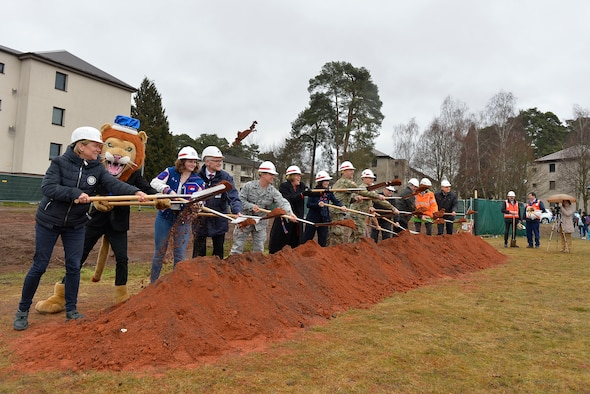 Military and civilian officials conduct a groundbreaking ceremony for a new school building on Ramstein Air Base, Germany, March 28, 2018. The Kaiserslautern Military Community has pushed to replace its old school buildings with futuristic 21st century educational facilities, which are characterized by student-centeredness, energy efficiency, and flexibility to accommodate multiple learning styles. (U.S. Air Force photo by Senior Airman Joshua Magbanua)