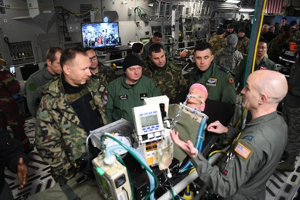 U.S. Air Force Capt. Arik Carlson, 10th Expeditionary Aeromedical Evacuation flight critical care air transport team (CCATT) nurse, explains the role of CCATT to Partnership Flight Symposium participants at Ramstein Air Base, Germany, Jan. 17, 2018. The CCATT's mission is to operate an intensive care unit in an aircraft during flight. (U.S. Air Force photo by Tech. Sgt. Rachelle Coleman)
