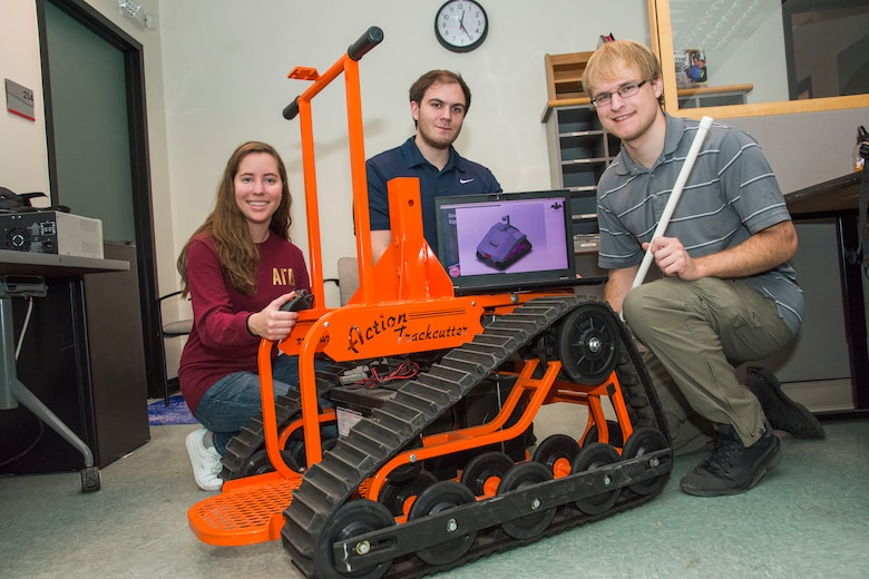 Students pose with robotic sentry wheelchair