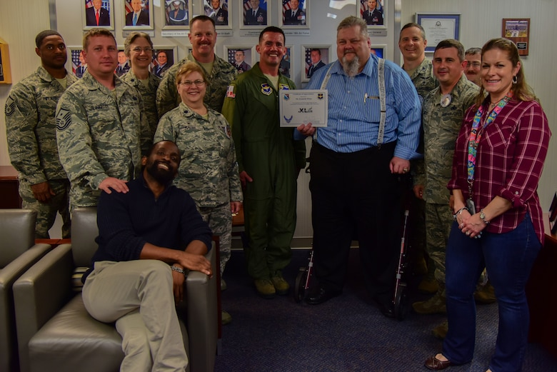 """Kenneth Wiese, 47th Medical Group director of quality services, was chosen by wing leadership to be the """"XLer"""" of the week, for the week of March 19, 2018, at Laughlin Air Force Base, Texas. The """"XLer"""" award, presented by Col. Charlie Velino, 47th Flying Training Wing commander, is given to those who consistently make outstanding contributions to their unit and the Laughlin mission. (U.S. Air Force photo/Airman 1st Class Marco A. Gomez)"""