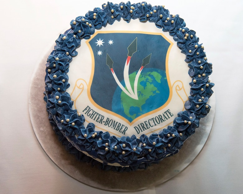 Brig. Gen. Heath Collins assumed leadership as PEO for Fighters Bombers during a March 28 ceremony. Following the ceremony, refreshments were available for attendees including a cake with the Fighter Bomber logo. (U.S. Air Force photo / Michelle Gigante)