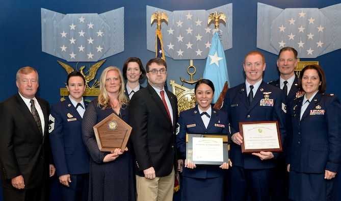 Members of the 919th Special Operations Force Support Squadron's Airman and Family Readiness Center team display their 2017 Department of Defense Reserve Family Readiness Awards