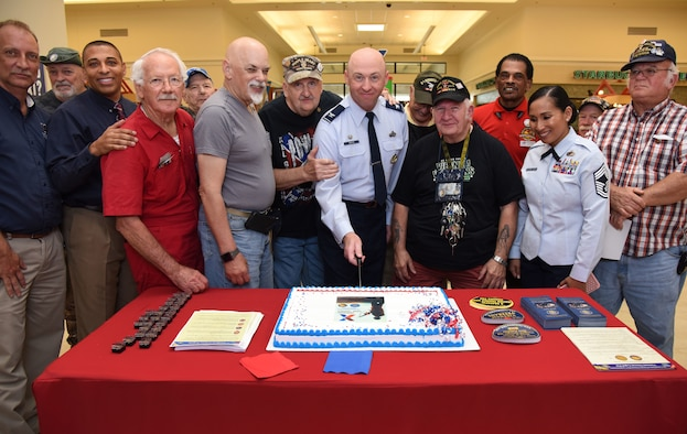 U.S. Air Force Col. Danny Davis, 81st Mission Support Group commander, participates in a cake cutting ceremony during the 50th Anniversary Vietnam Memorial Pinning Day at The Exchange March 29, 2018, on Keesler Air Force Base, Mississippi. The event, which also included a commemorative lapel pin presentation, was held to honor Vietnam veterans for their service. (U.S. Air Force photo by Kemberly Groue)