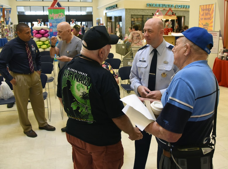 U.S. Air Force Col. Danny Davis, 81st Mission Support Group commander, speaks to Vietnam veterans during the 50th Anniversary Vietnam Memorial Pinning Day at The Exchange March 29, 2018, on Keesler Air Force Base, Mississippi. The event, which included a cake cutting ceremony and commemorative lapel pin presentation, was held to honor Vietnam veterans for their service. (U.S. Air Force photo by Kemberly Groue)