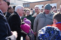 U.S. Vice President Mike Pence visits with people greeting him upon his arrival at the North Dakota Air National Guard Base, Fargo, N.D., March 27, 2018.