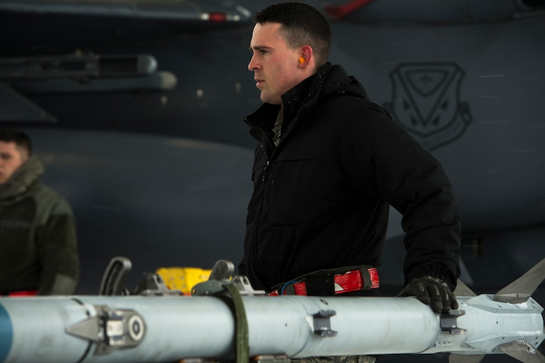 Staff Sgt. Cameron Delsol, 366th Maintenance Squadron weapons loadcrew team chief, prepares an AIM-9X Sidewinder to load onto an F-15E Strike Eagle March 1, 2018, at Mountain Home Air Force Base, Idaho. The AIM-9X is a short-range, air-to-air missile that will increase pilots abilities to track their enemies.
