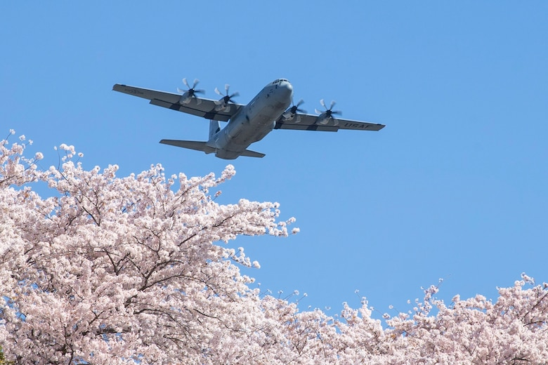 An Air Force C-130J Super Hercules assigned to the 36th Airlift Squadron flies over Yokota Air Base