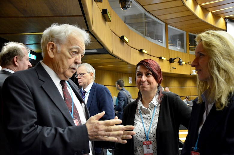Dr. Bob Kemerait (left), a senior scientist with the Air Force Technical Applications Center, discusses seismic research with Dr. Daniela Ghica (center), senior researcher at Romania's National Institute for Earth Physics and Dr. Mihaela Popa, Head of Romania's National Data Center, at the Comprehensive Test Ban Treaty Organization's headquarters in Vienna March 19, 2018.  (U.S. Air Force photo by Susan A. Romano)