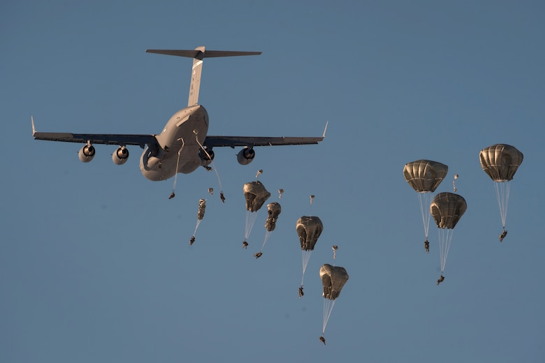 Paratroopers assigned to the 4th Infantry Brigade Combat Team (Airborne), 25th Infantry Division, U.S. Army Alaska, jump from an Air Force C-17 Globemaster III assigned to the 517th Airlift Squadron during airborne training over Malemute Drop Zone, Joint Base Elmendorf-Richardson, Alaska, March 22, 2018. The Soldiers of 4/25 belong to the only American airborne brigade in the Pacific and are trained to execute airborne maneuvers in extreme cold weather/high altitude environments in support of combat, training and disaster relief operations. (U.S. Air Force photo by Senior Airman Javier Alvarez)