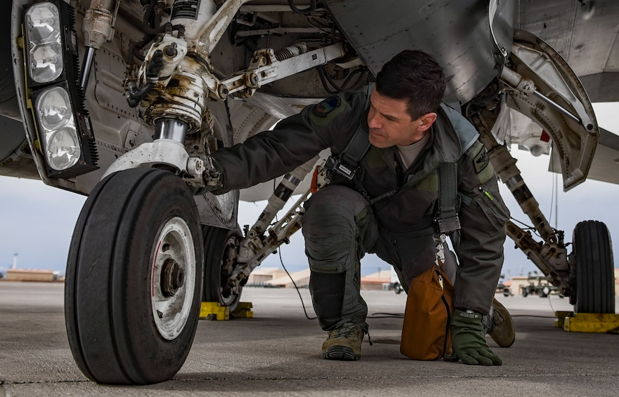Lt. Col. Daniel McGuire, 57th Wing fighter pilot, performs pre-flight checks on an F-16 Fighting Falcon at Nellis Air Force Base, Nevada, Feb. 27, 2018. (U.S. Air Force photo by Airman 1st Class Andrew D. Sarver)