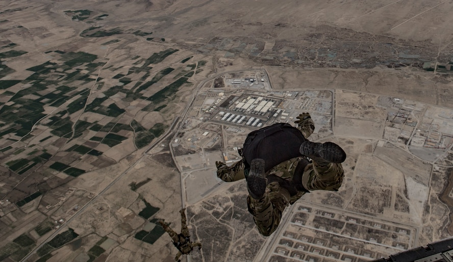 A Guardian Angel team, assigned to the 83rd Expeditionary Rescue Squadron, conducts a high-altitude, low-opening military free fall jump from a C-130J Super Hercules, flown by the 774th Expeditionary Airlift Squadron, Bagram Airfield, Afghanistan, March 23, 2018. The Guardian Angel team is responsible for training on all aspects of combat, medical procedures and search and rescue tactics, so they can provide the highest level of tactical capabilities to combatant commanders. (U.S. Air Force Photo by Tech. Sgt. Gregory Brook)