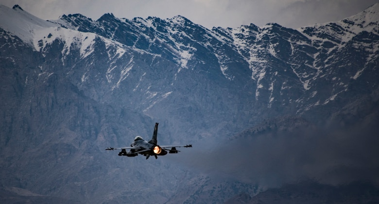 A U.S. Air Force F-16 Fighting Falcon, assigned to the 455th Expeditionary Fighter Wing, takes off from Bagram Airfield, Afghanistan in support of Operation Freedom's Sentinel, March 23, 2018. The F-16's conduct combat air patrol providing security assistance for ongoing ground operations in Afghanistan. (U.S. Air Force Courtesy Photo Edited by Tech. Sgt. Gregory Brook)