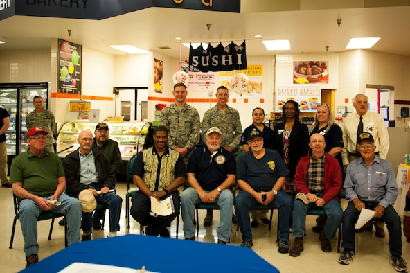U.S. Air Force Col. Jason Beck, 17th Mission Support Group commander, and Capt. Brent Little, 17th Training Wing chaplain, pose for a group photo with Vietnam veterans during a recognition ceremony at the Commissary on Goodfellow Air Force Base, Texas, March 29, 2018. The 29th of March is the designated day of remembrance for Vietnam veterans, a war that ended nearly 43 years ago.
