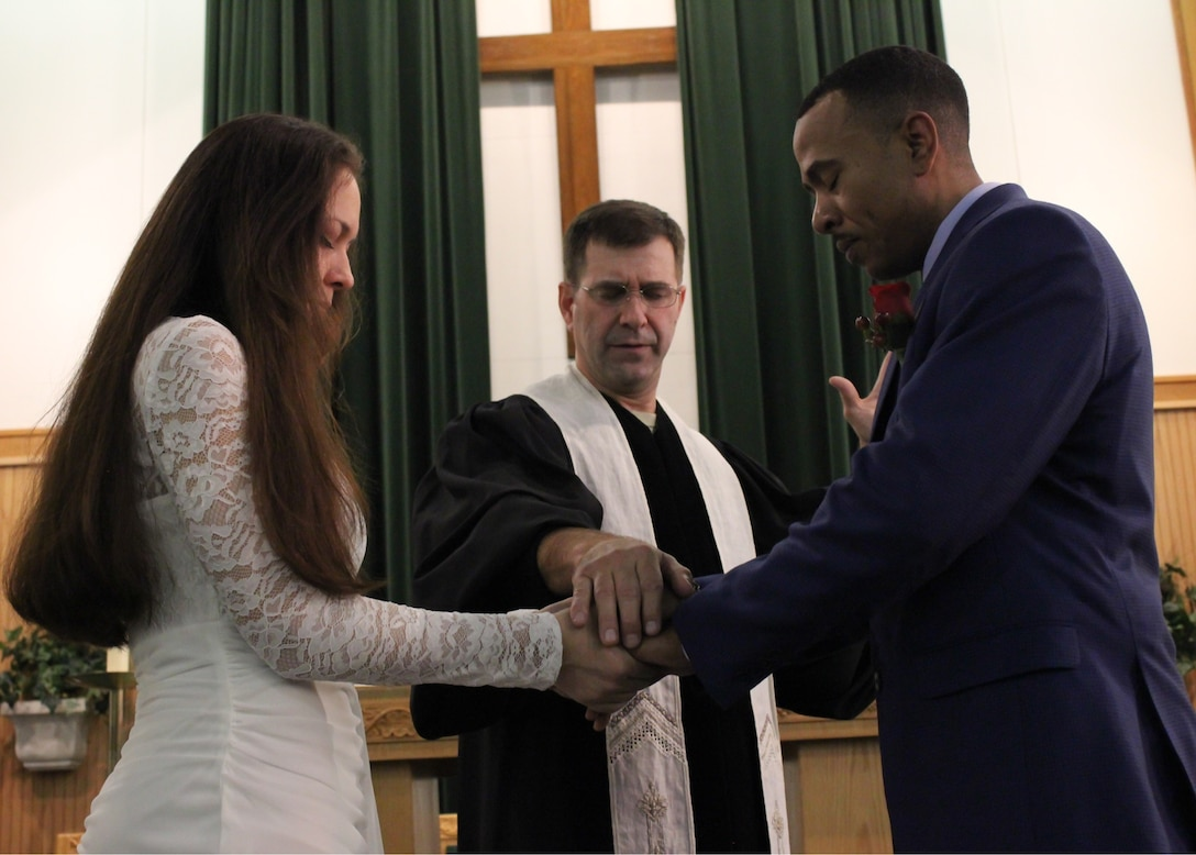 Maj. Bradley Kimble, 14th Flying Training Wing deputy chaplain, marries Master Sgt. Tabitha Flemming, 14th Medical Support Squadron superintendent, Senior Master Sgt. Ashley Flemming, Defense Contract Management Agency, Nov. 15, 2017. The 14th FTW Chapel offers counseling, religious and spiritual programs to help Airmen keep their family and faith healthy.(U.S. Air Force photo by Airman 1st Class Beaux Hebert)