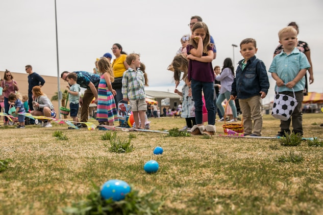 Children of Marines and sailors  with 1st Battalion, 7th Marine Regiment, line up to begin an Easter egg hunt during a spring family day at Victory Field aboard the Marine Corps Air Ground Combat Center, Twentynine Palms, Calif., March 24, 2018. The unit family readiness officer hosts events like spring family day to enhance camaraderie, bring spouses together to form positive relationships and create activities for the children. (U.S. Marine Corps photo by Lance Cpl. Margaret Gale)