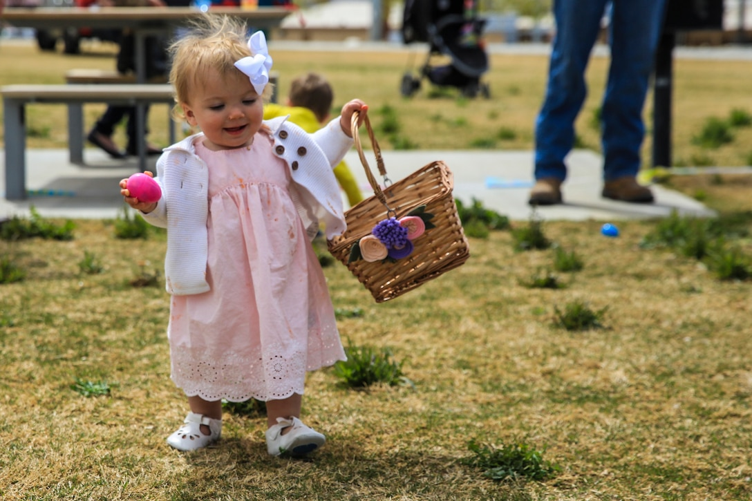 Piper Wetherill, daughter of Capt. Sean Wetherill, logistics officer, 1st Battalion, 7th Marine Regiment, participates in an Easter egg hunt during a spring family day at Victory Field aboard the Marine Corps Air Ground Combat Center, Twentynine Palms, Calif., March 24, 2018. The unit family readiness officer hosts events like spring family day to enhance camaraderie, bring spouses together to form positive relationships and create activities for the children. (U.S. Marine Corps photo by Lance Cpl. Margaret Gale)