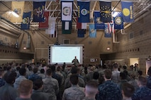 U.S. Air Force Col. Mike Manion, 55th Wing commander, speaks at a 55th Security Forces Squadron all call March 27, 2018, at Offutt Air Force Base, Nebraska. Due to a recent uptick of security breaches at Air Force bases across the world, Chief of Staff of the Air Force Gen. David Goldfein directed installation commanders to address potential vulnerabilities March 26. (U.S. Air Force photo by Senior Airman Jacob Skovo)