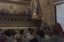 U.S. Air Force Lt. Col. William Smith, 55th Secuirty Forces Squadron commander, speaks at a 55th SFS all call March 27, 2018, at Offutt Air Force Base, Nebraska. Due to a recent uptick of security breaches at Air Force bases across the world, Chief of Staff of the Air Force Gen. David Goldfein directed installation commanders to address potential vulnerabilities March 26. (U.S. Air Force photo by Senior Airman Jacob Skovo)