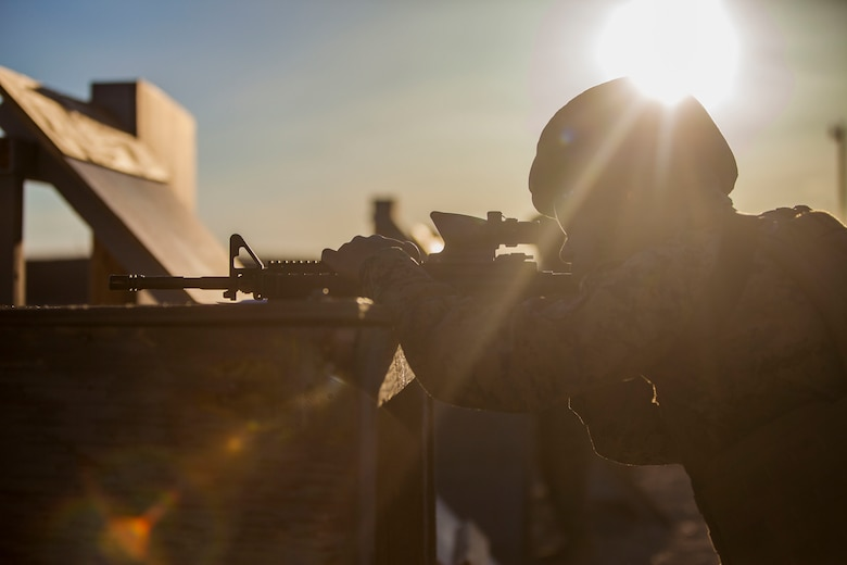 Pfc Antonio T. Reviere, Administration Clerk, Alpha Company, Headquarters Battalion, shoots an M4 Carbine for tables three and four aboard  the Marine Corps Air Ground Combat Center, Twentynine Palms, Calif., March 23, 2018. The annual marksmanship qualification allows Marines to validate and improve proficiency in shooting and maneuvering with their weapon.  (U.S. Marine Corps photo by Lance Cpl. Jennessa Davey)