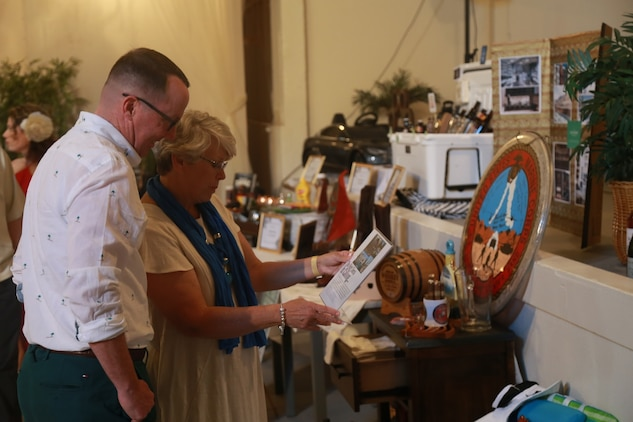 Guests look at one of many auction bundles during the Havana Nights Gala & Benefit Auction hosted by Smith's Ranch in Twentynine Palms, Calif., March 24, 2018. Havana Nights is an annual benefit auction hosted by the Officers' Spouses' Club to raise money for their Scholarship Grant Program, which provides community members with grants to continue their education. (U.S. Marine Corps photo by Lance Cpl. Preston L. Morris)