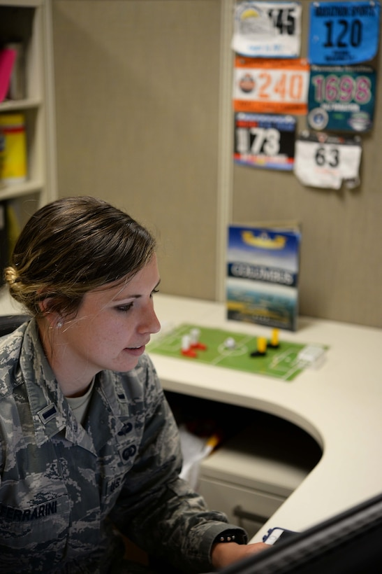 First Lt. Hannah Ferrarini, 14th Force Support Squadron officer in-charge of Career Development works at her desk March 27, 2018, on Columbus Air Force Base, Mississippi. She has completed numerous races since her injury over 5 years ago even though her doctors originally predicted she might not ever run again. (U.S. Air Force photo by Airman 1st Class Keith Holcomb)