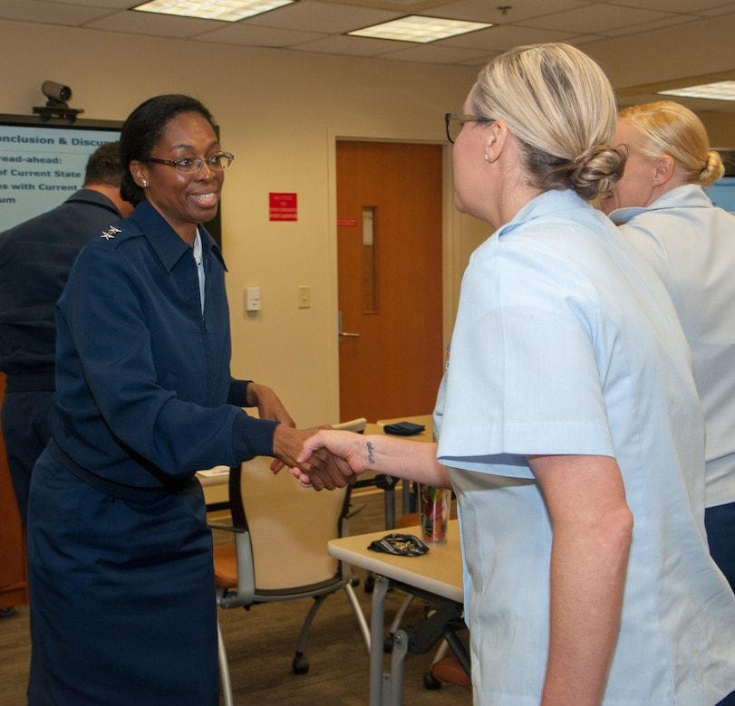 Health Service Technicians 1st Class Heidi Bennett, center, and Nicole Flores, right, Fleet Liaison Readiness Support for Coast Guard Charleston, greet Rear Adm. Erica Schwartz, left, Director of Health, Safety and Work-Life for the U.S. Coast Guard, during Schwartz's visit Naval Health Clinic Charleston March 20. Schwartz and her staff met with Coast Guard and NHCC leaders before touring the health care facility. Bennet, Flores and two other Coast Guard health service technicians are embedded at NHCC to provide medical and dental care for Coast Guard personnel and their families stationed at Sector Charleston. Schwartz is responsible for the Coast Guard's health care system of 41 clinics and 150 sick bays, as well as, operational and off-duty mishap prevention, response and investigation. Schwartz oversees the Coast Guard's child care programs and food services delivery programs, ashore and afloat and the Coast Guard's Ombudsman, Substance Abuse, Health Promotion and Sexual Assault Prevention and Response programs.