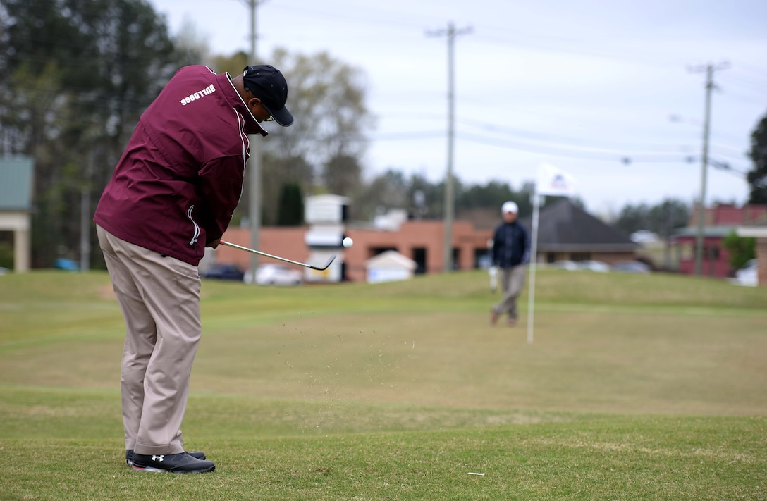 Milton Rawl chips on the 8th hole March 26, 2018 at Lion Hills Columbus Country Club in Columbus, Mississippi. Rawl was participating in the Happy Irby Golf Tournament fundraiser, focused on helping donate items to children in need across the local community. (U.S. Air Force photo by Airman 1st Class Keith Holcomb)