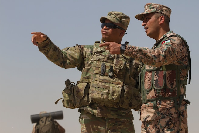 Master Sgt. Tom Scott Jr., subject matter expert, 648th Military Engagement Team, Georgia Army National Guard, and Command Sgt. Maj. Mohammad Al-Smadi, commandant, Jordan Armed Forces Noncommissioned Officer Academy, observe and discuss training during the JAF NCOA Squad Leader Course, March 18, 2018, near Amman, Jordan. The 648th MET advised JAF NCOA instructors as the Jordanian leaders developed the program of instruction for the course, which is attended by their soldiers and their regional allies. (U.S. Army photo by Sgt. Thomas X. Crough, USARCENT PAO)