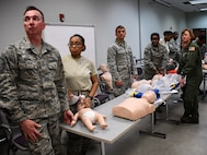 Medical personnel listen to instructions for their next step in a basic life saving class.  The course is a refresher for most members of the 932nd Medical Group and 932nd Aeromedical Evacuation Squadron seen here.  The instructor and demonstration video combination explained the intricate methods for taking care of babies and small children during this class held March 6, 2018, at the 932nd Medical Group, Scott Air Force Base, Ill.  (U.S. Air Force photo by Lt. Col. Stan Paregien) #932nd #AFReserve #airman