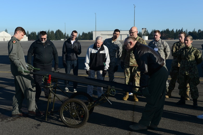 Members of the Association of Military Osteopathic Physicians and Surgeons (AMOPS) practice using a NATO litter carrier, March 10, 2018, at Joint Base Lewis-McChord, Wash. AMOPS members included military doctors, medical students on military scholarships and retirees. (U.S. Air Force photo by Airman 1st Class Sara Hoerichs)