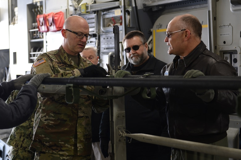 Members of the Association of Military Osteopathic Physicians and Surgeons secure a stretcher to a stanchion in a C-17 Globemaster III, March 10, 2018, at Joint Base Lewis-McChord, Wash. The stanchions can accommodate three stretchers, saving space and allowing the C-17 to transport more patients at a time. (U.S. Air Force photo by Airman 1st Class Sara Hoerichs)