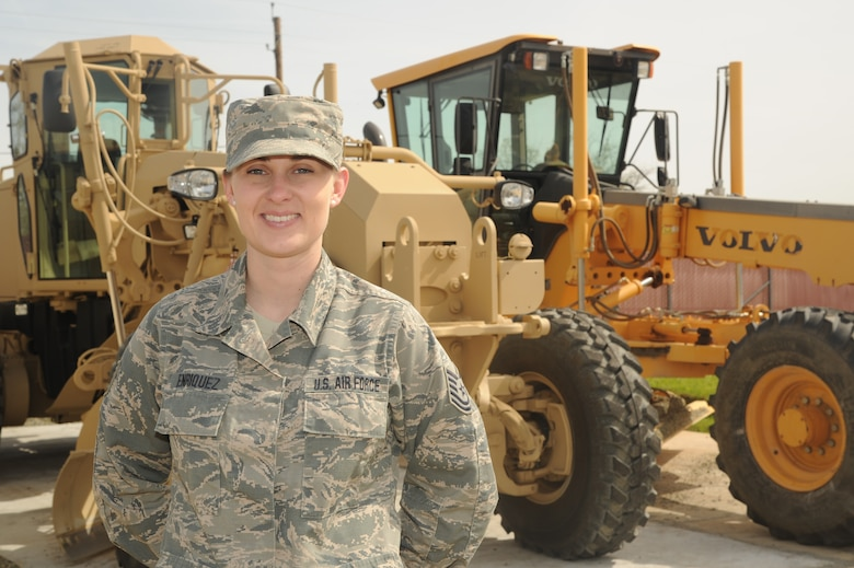 Tech. Sgt. Christy M. Enriquez, a Reserve Citizen Airman with the 940th Civil Engineer Squadron, stands in front of heavy equipment March 30, 2018, at Beale Air Force Base, California.