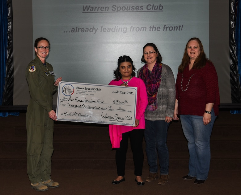 The Warren Spouse Club presented Col. Stacy Jo Huser, 90th Missile Wing commander, with a check for $5,100 for the Air Force Assistance Fund at F.E. Warren Air Force Base, Wyo., March 30, 2018. The WSC raised the money during a recent auction event, Boots and Baubles. AFAF helps Airmen with financial aid in instances such as, emergency situations, securing a retirement home for widows or widowers of Air Force members and more. (U.S. Air Force photo by Airman 1st Class Braydon Williams)