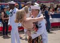 180330-N-LY160-0135 PEARL HARBOR, Hawaii (March 30, 2018) Sonar Technician Submarine 2nd Class Michael Mize, assigned to the Virginia-class fast-attack submarine USS Mississippi (SSN 782), hugs his loved during a homecoming ceremony in Joint Base Pearl Harbor-Hickam, March 30. Mississippi successfully completed a six-month Western Pacific deployment. (U.S. Navy photo by Mass Communication Specialist 2nd Class Michael H. Lee/ Released)